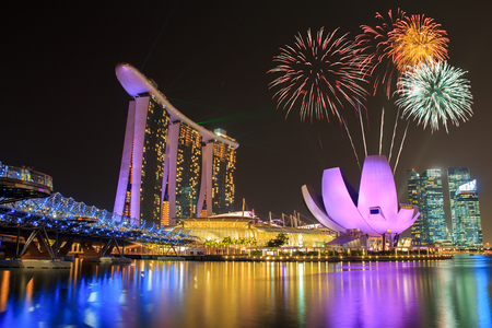 Photo for Fireworks over Marina bay in Singapore on national day fireworks celebration - Royalty Free Image