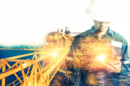 Photo for Double exposure of Engineer or Technician man with safety helmet operated platform or plant by using tablet with offshore oil and gas platform background for oil and gas business concept - Royalty Free Image