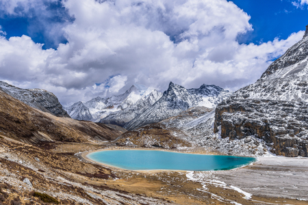 Photo for Green scared milk lake, also called niunai lake at a high altitude in Yading, Daocheng, Si Chuan Province. - Royalty Free Image