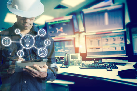 Photo for Double exposure of Engineer or Technician man with business industrial tool icons while using tablet with monitor of computers room  for oil and gas industrial business concept. - Royalty Free Image