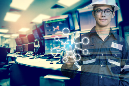 Photo for Double exposure of Engineer or Technician man with blank tool icons while pointing finger with monitor of computers room for oil and gas industrial business concept. - Royalty Free Image