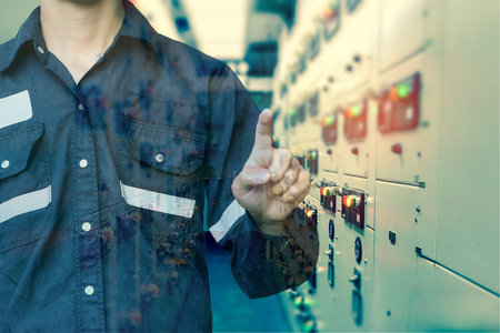 Foto für Double exposure of  Engineer or Technician man press his finger action in switch gear electrical room of oil and gas platform or plant industrial for monitor process, business and industry concept. - Lizenzfreies Bild