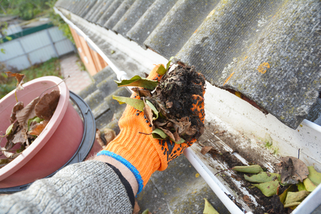 Foto de  Roof Gutter Cleaning Tips. Clean Your Gutters. Gutter Cleaning. - Imagen libre de derechos