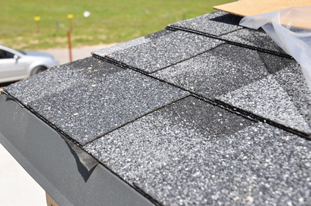 Photo for Asphalt Shingles Roof Installation.  Install Asphalt Roofing Shingles. Roof Shingles - Roofing Construction, House Roofing Repair. - Royalty Free Image