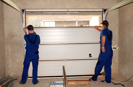 Photo pour Contractors Installing, Repair, Insulating Garage Door. Garage door seal, garage door replacement, garage door repair. - image libre de droit