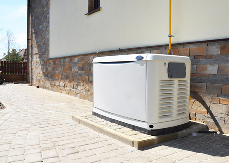 Photo pour Residential house natural gas backup generator. Choosing a location for house standby generator. - image libre de droit