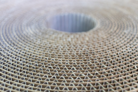 Foto de Top-down view of a spool of cardboard at an angle with blurry background - Imagen libre de derechos