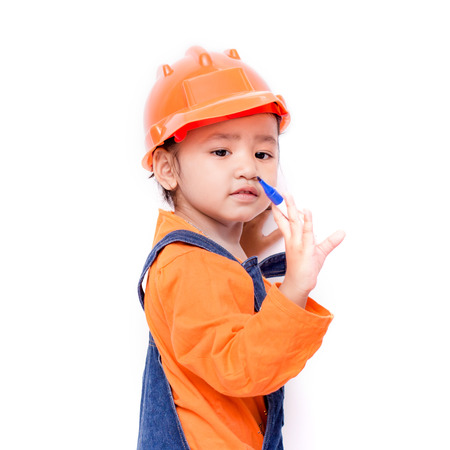 Asian Engineer baby girl with pen in hand on white background