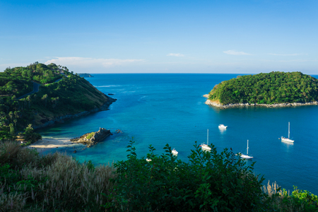 Photo for Blue sea rock beach with island and yacht boat vacation time - Royalty Free Image