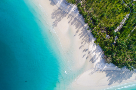 Foto de Amazing island with sand beach green tree forest aerial view blue sea water - Imagen libre de derechos
