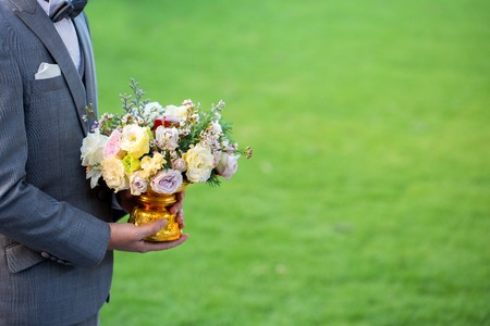Photo for Flowers in hand groom - Royalty Free Image