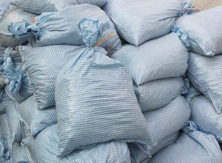 Photo for Sand bags help keep flood waters out of a town Process - Royalty Free Image