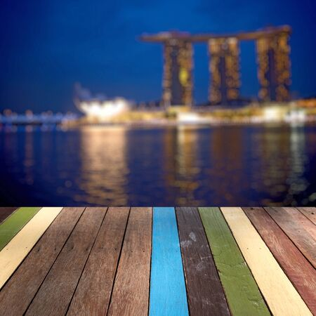 Wood table top Singapore landmark background montage concept