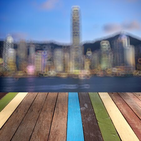Wood table top Hongkong landmark background montage concept