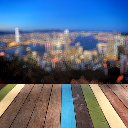 Wood table top Hongkong landmark montage concept