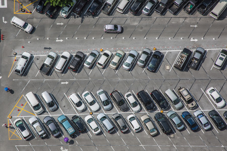 Foto de Car parking lot viewed from above, bird eye view - Imagen libre de derechos