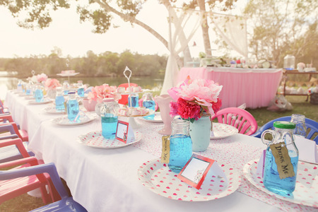 Foto de Alice in wonderland Mad Hatters tea party table setting,toning - Imagen libre de derechos