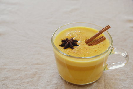 Photo for Turmeric latte, Golden milk, Turmeric milk, healthy hipster drink - Royalty Free Image