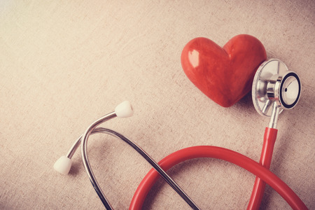 Photo pour red heart with stethoscope, heart health,  health insurance concept - image libre de droit