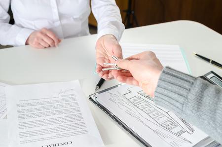 Photo pour handing the keys to his client in real estate agency - image libre de droit