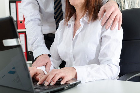 Photo pour Manager putting his hand on the shoulder of his secretary, at the office - image libre de droit
