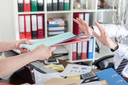 Overworked businessman refusing work