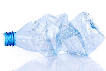 Foto de Crushed plastic bottle, isolated on white - Imagen libre de derechos