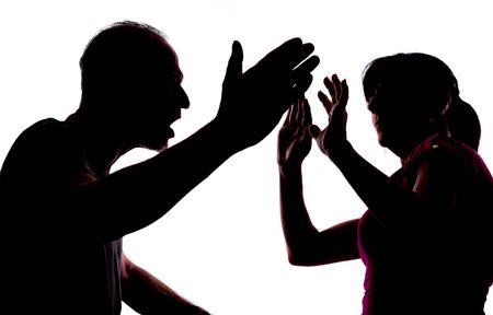 Foto de Silhouette showing domestic violence - Imagen libre de derechos