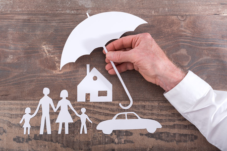 Foto de House, car and family protected with an umbrella - insurance concept - Imagen libre de derechos