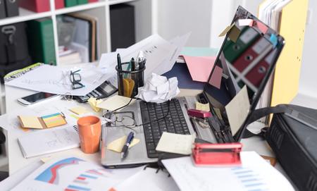 Photo pour Messy and cluttered office desk - image libre de droit
