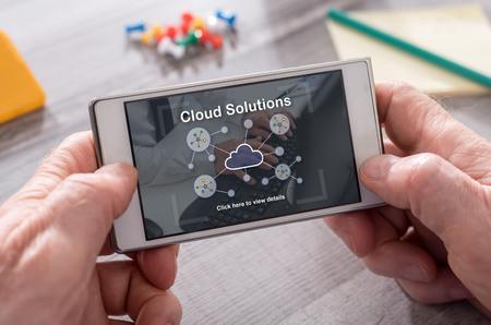 Photo pour Cloud solutions concept on mobile phone - image libre de droit
