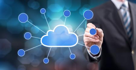 Foto für Man touching a cloud networking on a touch screen with a stylus pen - Lizenzfreies Bild
