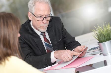 Photo pour Financial consultant giving advices to female client, light effect - image libre de droit