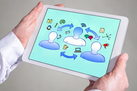 Photo pour Tablet screen displaying a communication concept - image libre de droit