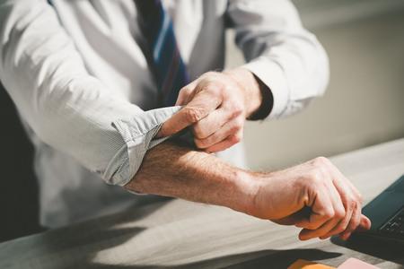 Photo pour Businessman rolling up his sleeves, concept of motivation - image libre de droit