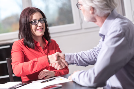Photo for Handshake between woman and man at office after interview - Royalty Free Image