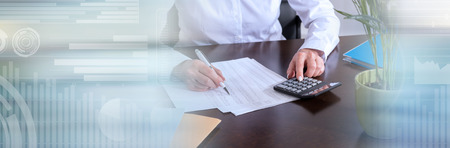 Photo pour Woman with calculator doing her accounting. panoramic banner - image libre de droit