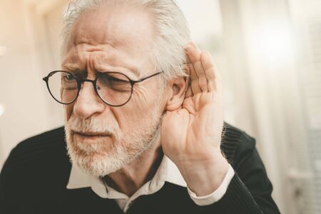 Photo for Portrait of senior man having hearing problems - Royalty Free Image