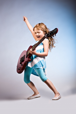 Photo pour portrait of young girl with a guitar on the stage - image libre de droit