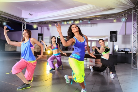 Photo for young women in sport dress at an aerobic and zumba exercise - Royalty Free Image