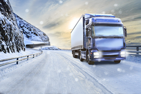 Photo for a truck on the wintry road, symbolic picture for cargo and transportation companies - Royalty Free Image