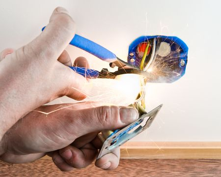 Electician cutting live wire causing short circuit