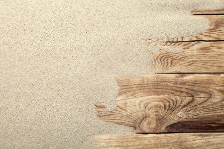 Photo pour Sand on planked wood. Summer background with copy space. Top view - image libre de droit