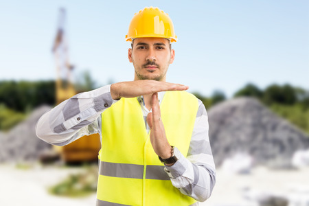 Photo pour Architect or engineer making time out pause break gesture on construction site or pit outdoors - image libre de droit