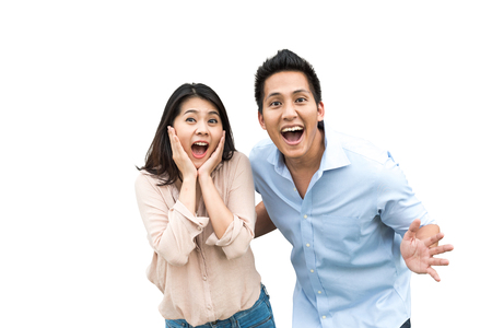Foto de Portrait of Asian couple with surprised and excited expression isolated on white background - Imagen libre de derechos