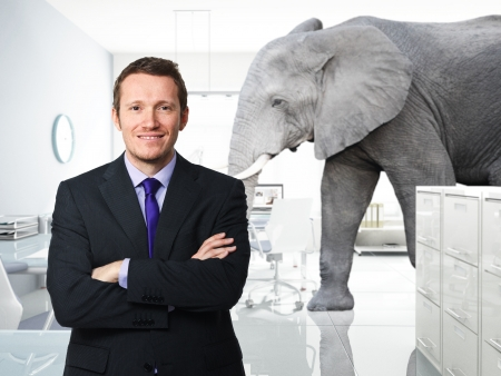 smiling man and elephant in modern office