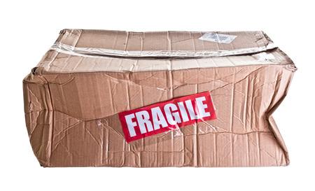 Foto de damaged cardboard parcel on white background - Imagen libre de derechos