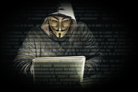 Foto de portrait of hacker and binary code - Imagen libre de derechos