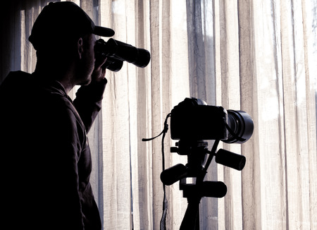 Foto de man with binoculars and camera control someone - Imagen libre de derechos
