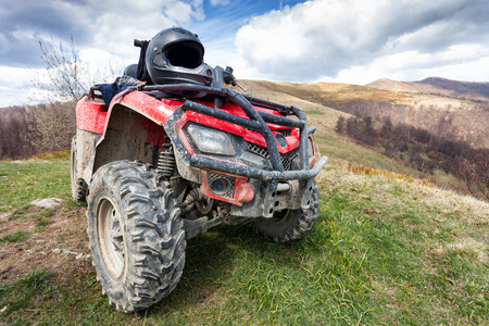 Photo for ATV on mountains landscape on a sunny day - Royalty Free Image